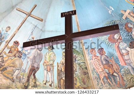 CEBU - MAY 14: Magellan's Cross in a chapel on May 14, 2012 in Cebu, Philippines. Magellan's Cross - popular tourist attraction was erected in 1521 as a symbol of the arrival of Ferdinand Magellan. - stock photo