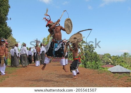 Cecer Village, Indonesia-Apr. 21:  Caci dancers perform a traditional dance for visiting tourists.  Once performed prior to war but is now done for ceremonial and welcoming purposes on April 21, 2014. - stock photo