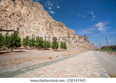 Cedar forest at the foot of the rocky mountains in the valley of the Middle East - stock photo