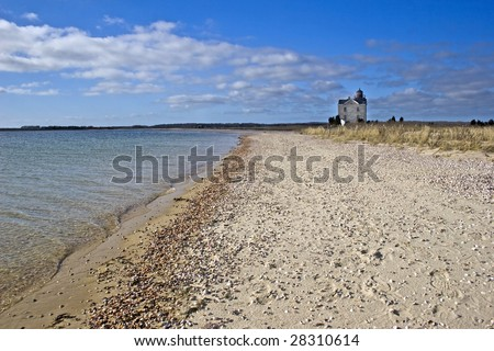 Cedar Point Lighthouse overlook Gardiner's Bay. Built in 1860 and decommissioned in 1934. Located in East Hampton, Long Island, New York. - stock photo