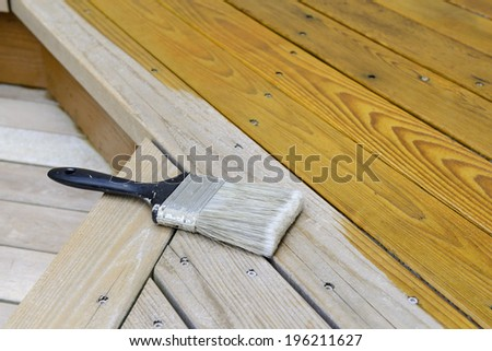 Cedar Porch Being Stained - stock photo
