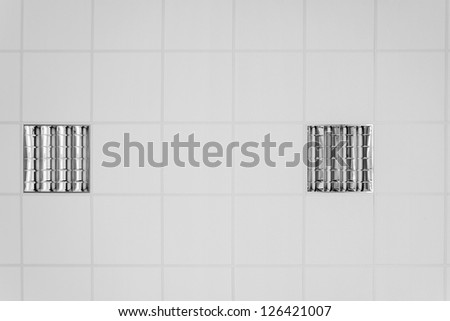 Ceiling detail with a couple of lamps, standard in every office - stock photo