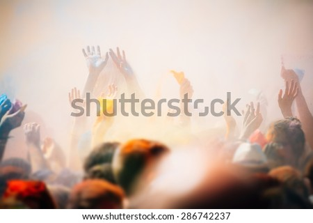 Celebrants dancing during the color Holi Festival - stock photo
