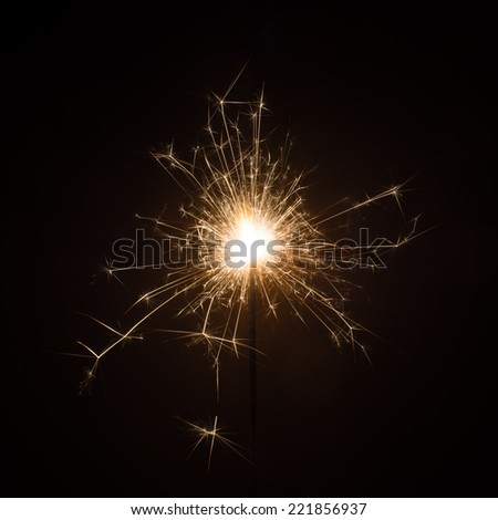 Celebrate party sparkler little fireworks on black background. Use for Christmas and New year and other celebration. - stock photo