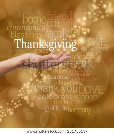 Celebrate Thanksgiving - Golden bokeh and graffiti background with a string of glittery sparkles and a female hand outstretched with a white 'Thanksgiving' word floating above  - stock photo
