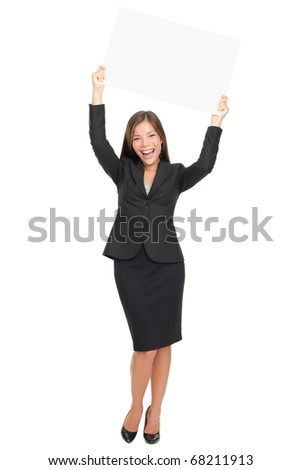 Celebrating happy business woman winner showing empty blank sign above her head. Isolated on white background. - stock photo