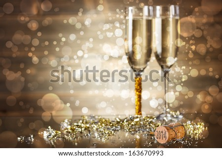 Celebrating New Year with champagne  - stock photo