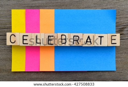 """celebration background - The word """"celebrate"""" with bright multicolored sticky notes in the back - stock photo"""