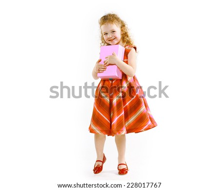 Celebration, birthday, christmas and people concept - happy little girl in dress with gift box - stock photo