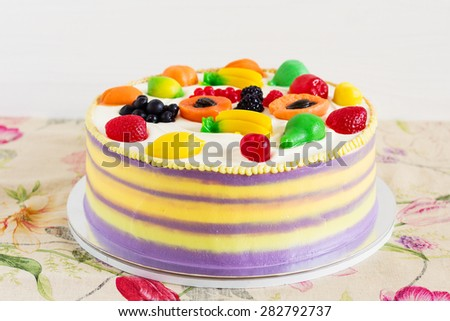 Celebration colorful cake decorated with fruit jelly for kids party  - stock photo