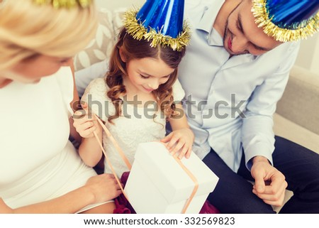 celebration, family, holidays and birthday concept - happy family with gift box - stock photo