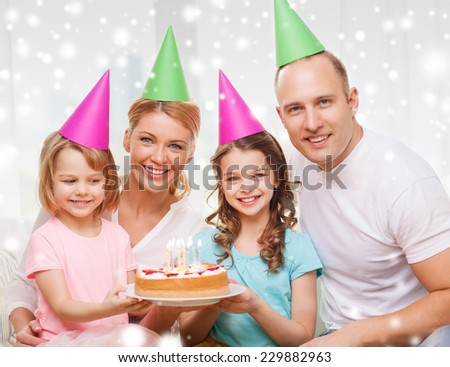 celebration, family, holidays and people concept - happy family with two kids in party hats at home - stock photo