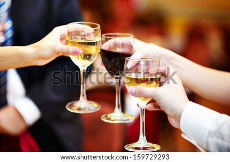 Celebration. People holding glasses of alcohol making a toast - stock photo