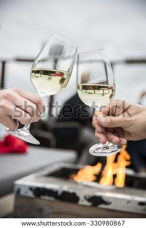 Celebration. People holding glasses of white wine making a toast - stock photo