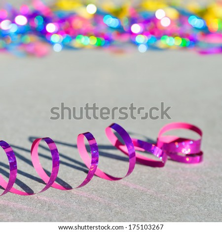 Celebration - streamer on the ground - symbol for celebration and party - stock photo