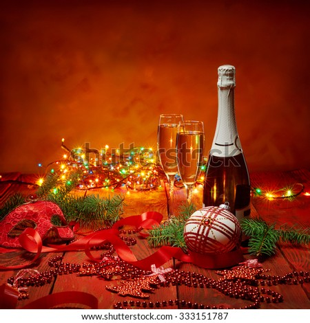 Celebration theme with champagne wine and Christmas decoration - stock photo