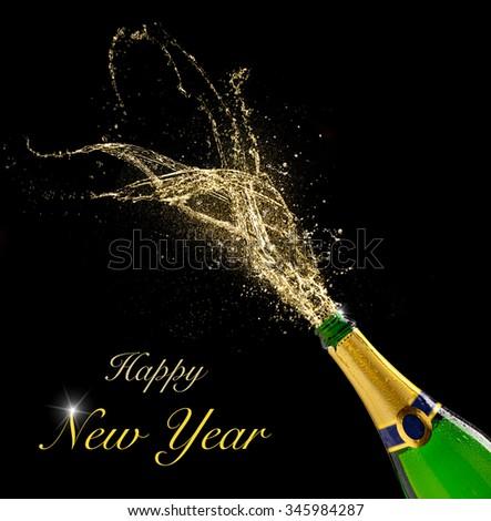 Celebration theme with splashing champagne, isolated on black background - stock photo