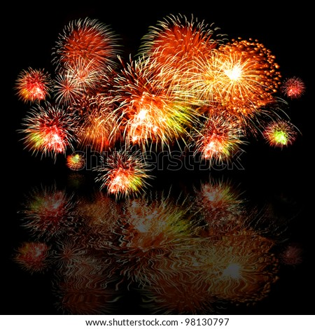Celebratory bright firework  with reflection - stock photo