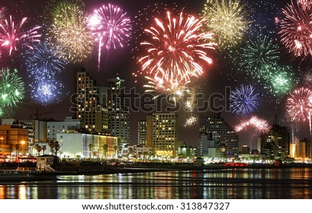 Celebratory fireworks at coast of Tel Aviv (Mediterranean sea. Israel) - stock photo