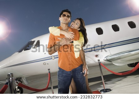 Celebrity Couple Alighting From Private Jet - stock photo
