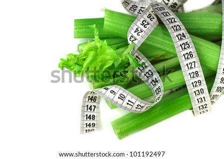 Celery and measure tape diet concept isolated on white corner composition - stock photo