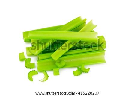 Celery Chopped Into Pieces Isolated on White Background. Studio Photo - stock photo