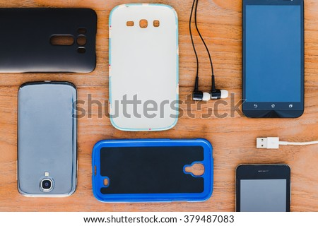 Cell phone and accessories for background - stock photo