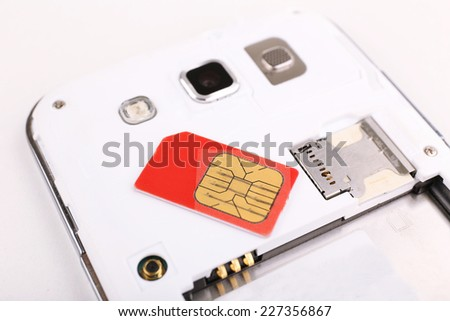 cell phone and sim card, isolated on white - stock photo