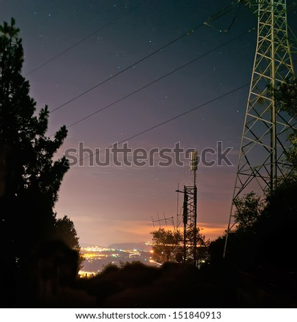 cell phone antenna by night  - stock photo