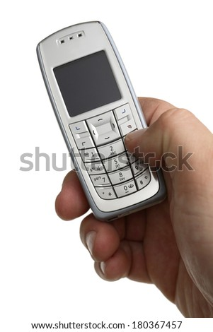 Cell phone in hand on white background - stock photo