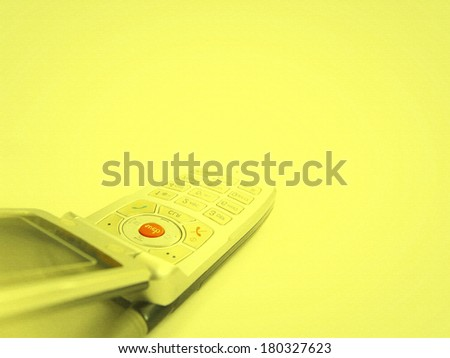 Cell phone isolated on yellow - stock photo