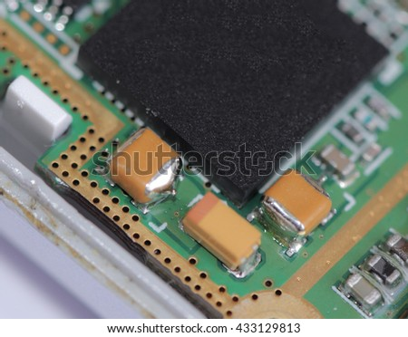 Cell phone mother board gilded contacts macro close up - stock photo