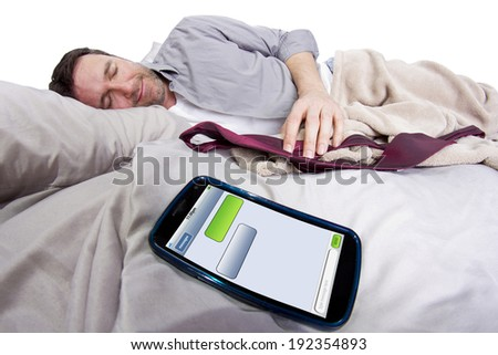 cell phone screen showing text messages while male is in bed. blank for copyspace - stock photo