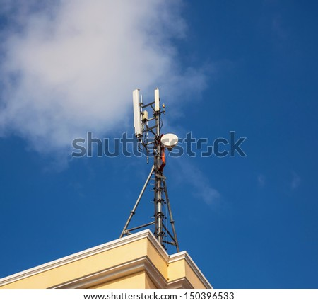 Cell Phone Tower and blue sky with cloud - stock photo