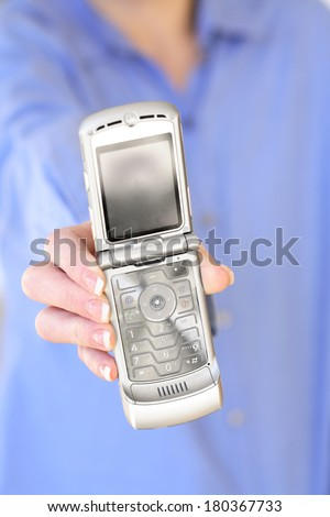 Cell phone with hand - stock photo