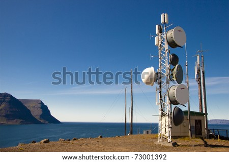 Cell tower on Arnarnes in background Isafjardardjup - Iceland. - stock photo