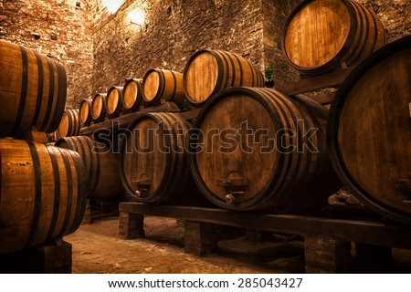 cellar with barrels for storage of wine, Italy - stock photo