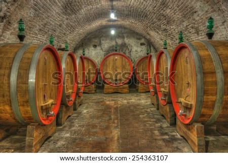 Cellar with barrels of wine - stock photo