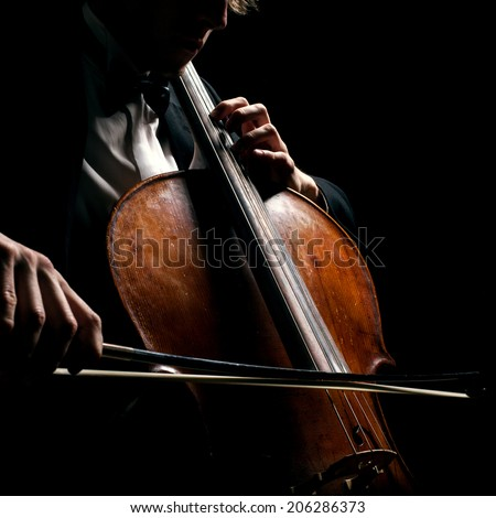 cellist on a black background - stock photo