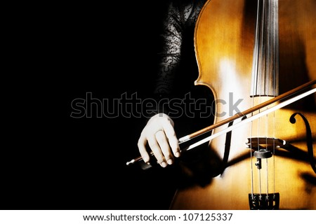 Cello classical music instrument of orchestra. Cellist on black background - stock photo