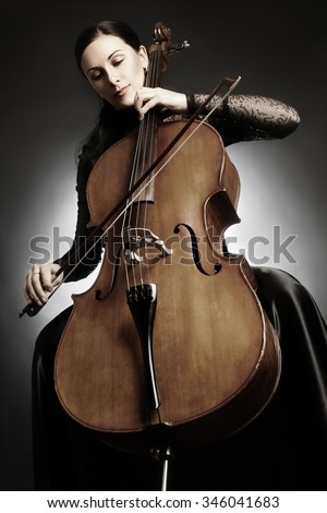 Cello player cellist playing music instrument Classical orchestra musician - stock photo
