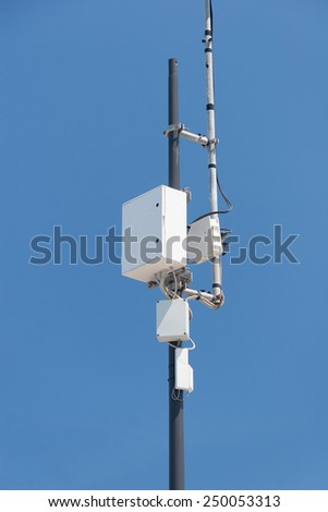 Cellular Communication tower against the blue sky - stock photo