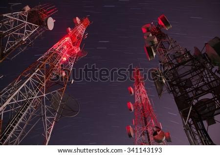 cellular communication towers on Night Sky - stock photo
