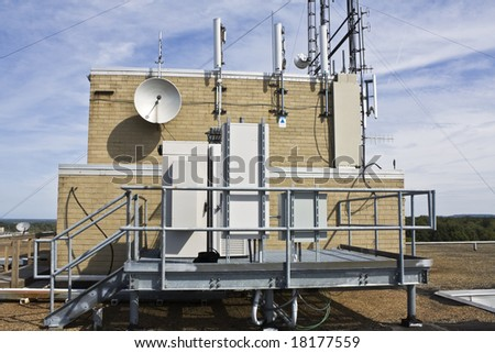 Cellular equipment on the platform installed on the rooftop - stock photo