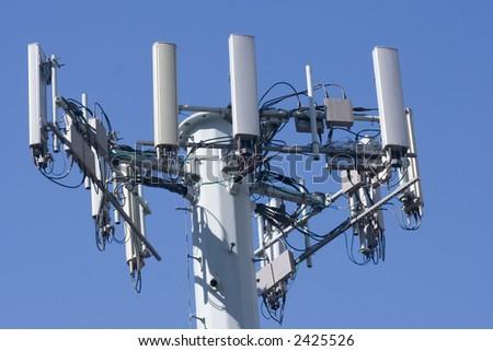 Cellular phone network telecommunication tower - stock photo