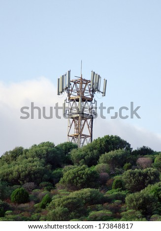 Cellular tower on the top of mountain. - stock photo