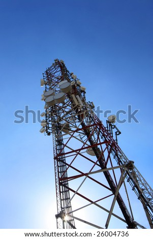 cellular tower with microwave transmitters - stock photo