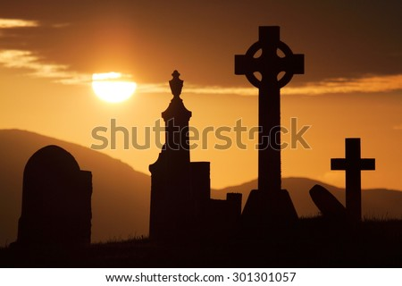 celtic cemetery dead sunset sea island of Skye scotland - stock photo