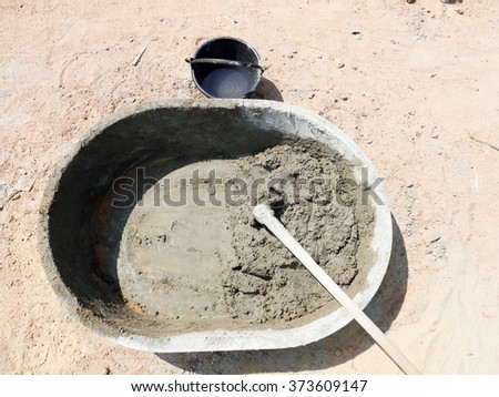 Cement and hoe - stock photo