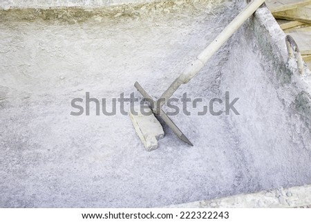 Cement and shovel work of construction material - stock photo